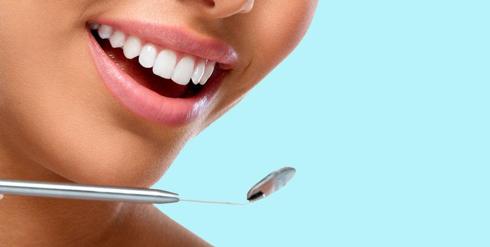 Лечение кариеса, удаление, отбеливание и установка имплантата в клинике Smart Dent
