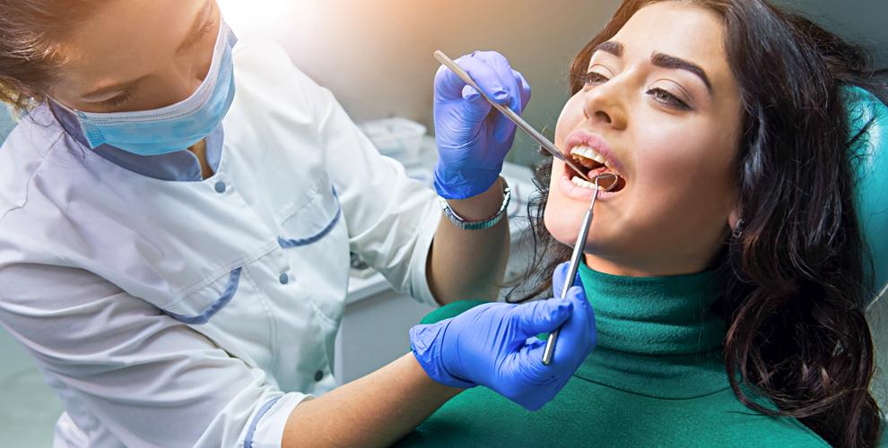 Установка коронки, лечение кариеса, реставрация зуба встоматологии SMILE