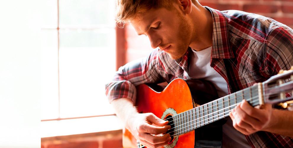 Индивидуальные занятия по вокалу, игре на гитаре и фортепиано в Top Music School
