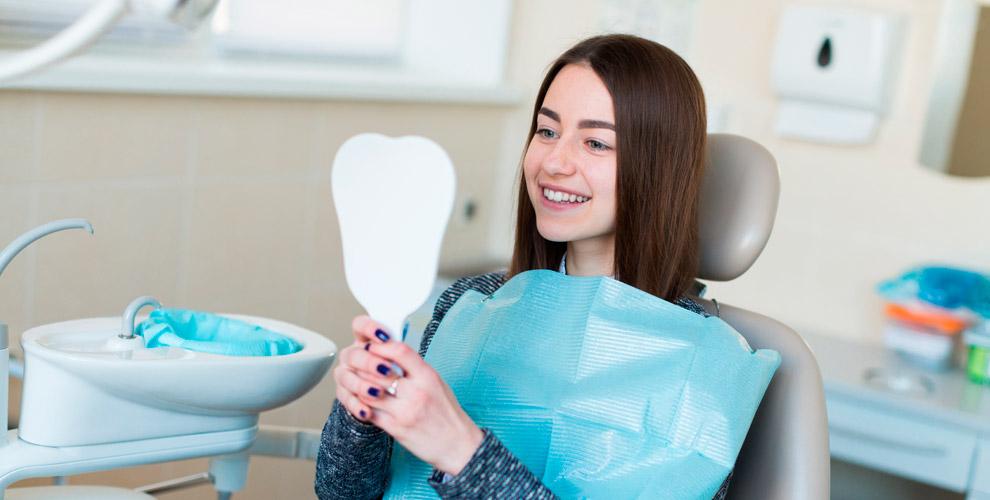 Эстетическая реставрация и установка металлокерамической коронки в стоматологии SMILE
