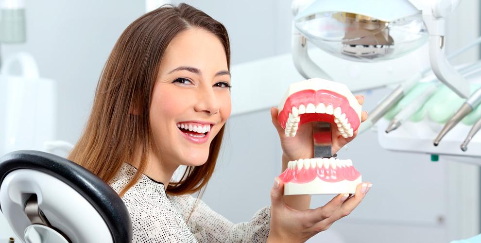 Удаление зуба, лечение кариеса и гигиена полости рта в центре стоматологии «Лакшми»