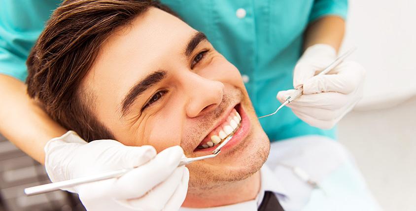 "Осмотр, план лечения, УЗ-чистка зубов и установка зубного имплантата в центре ""Амрита"""